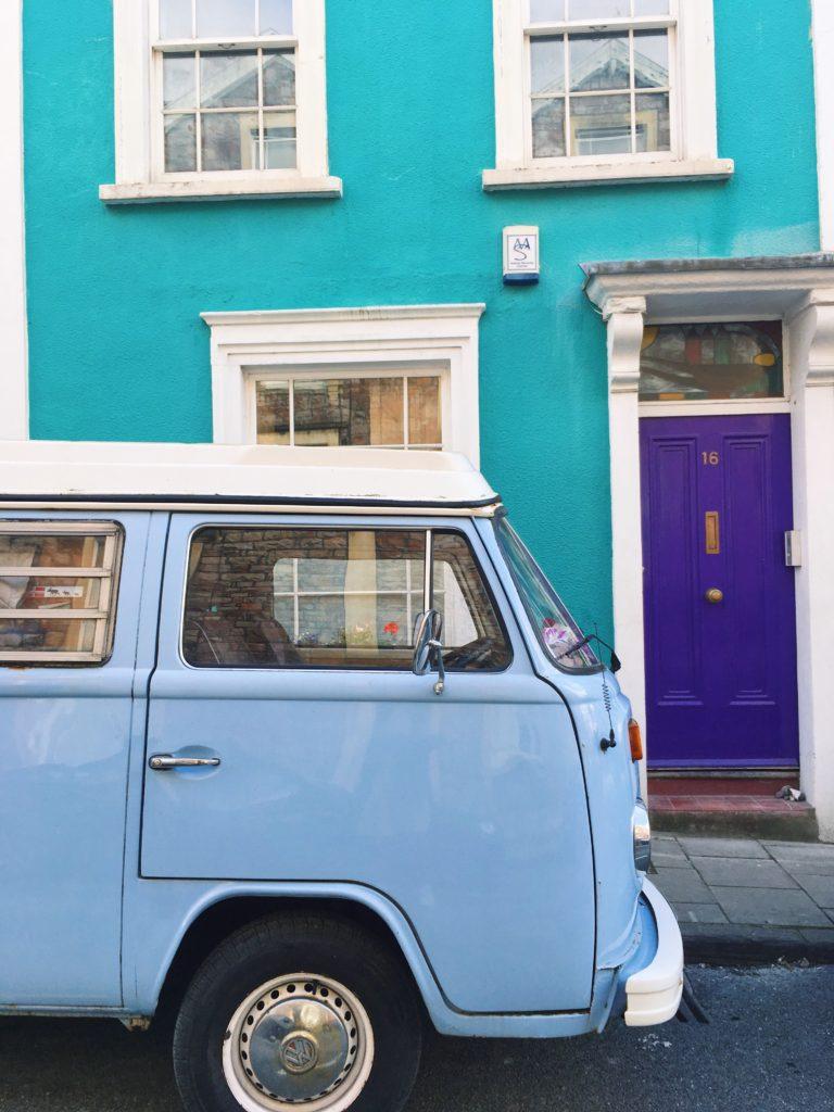 vw camper van in front of turquoise house colourful cliftonwood yellow feather blog