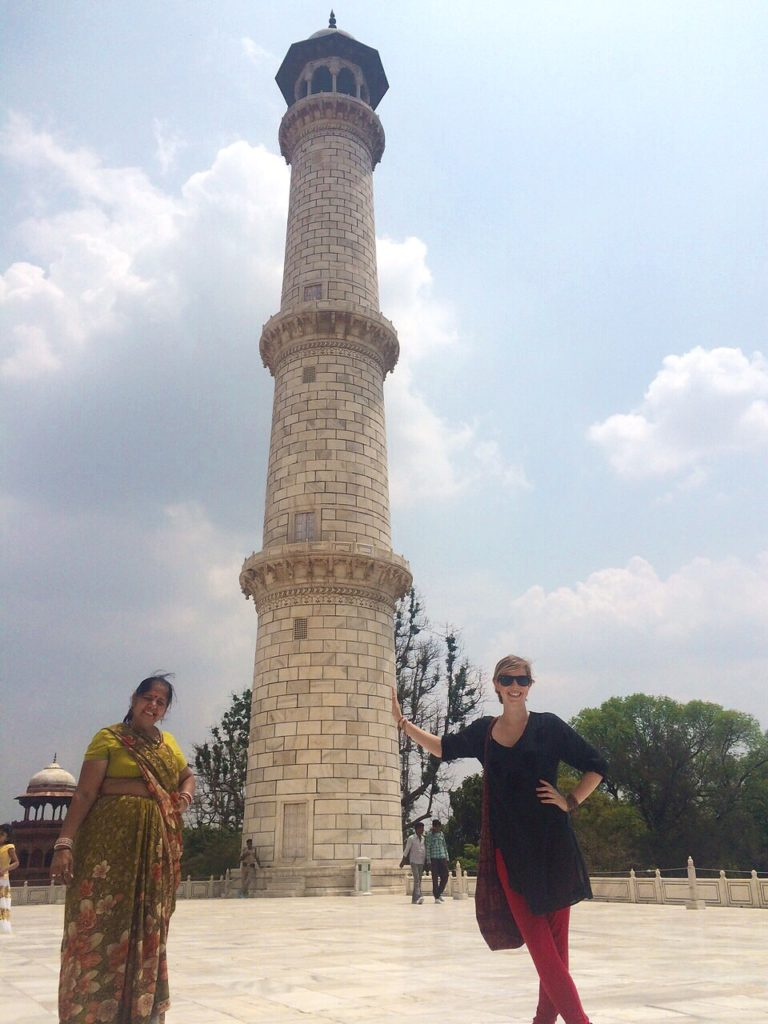 leaning against tower of taj mahal travel tuesday taj mahal yellow feather blog.JPG