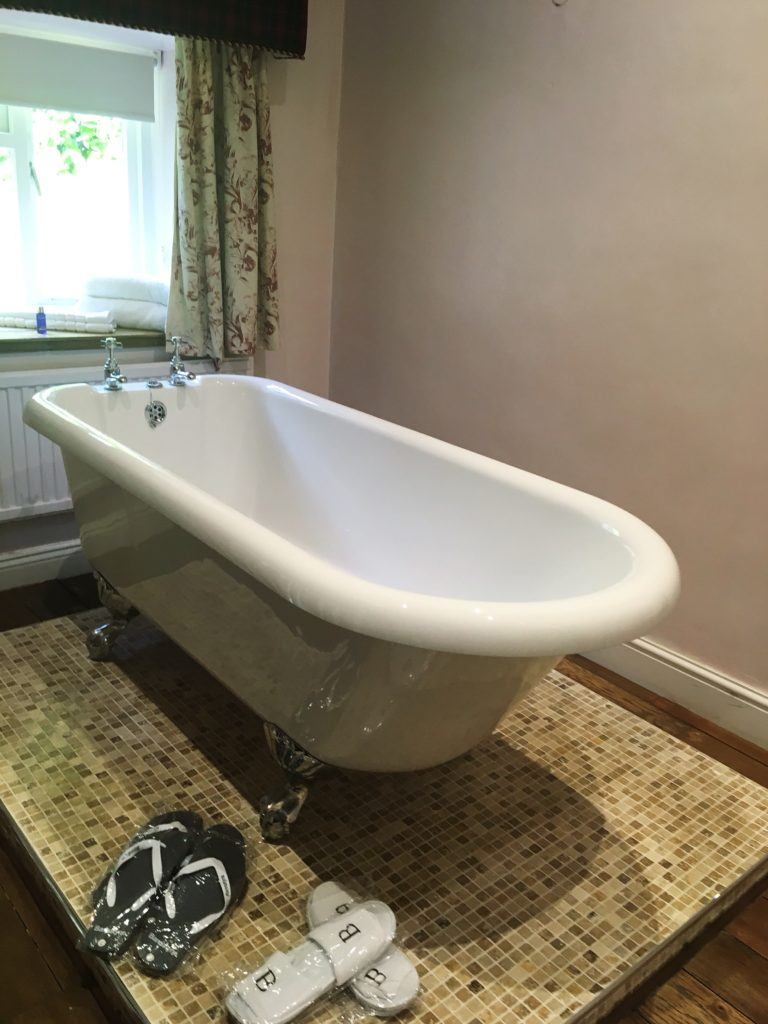 roll top freestanding bath in room yellow feather blog charlton house hotel spa