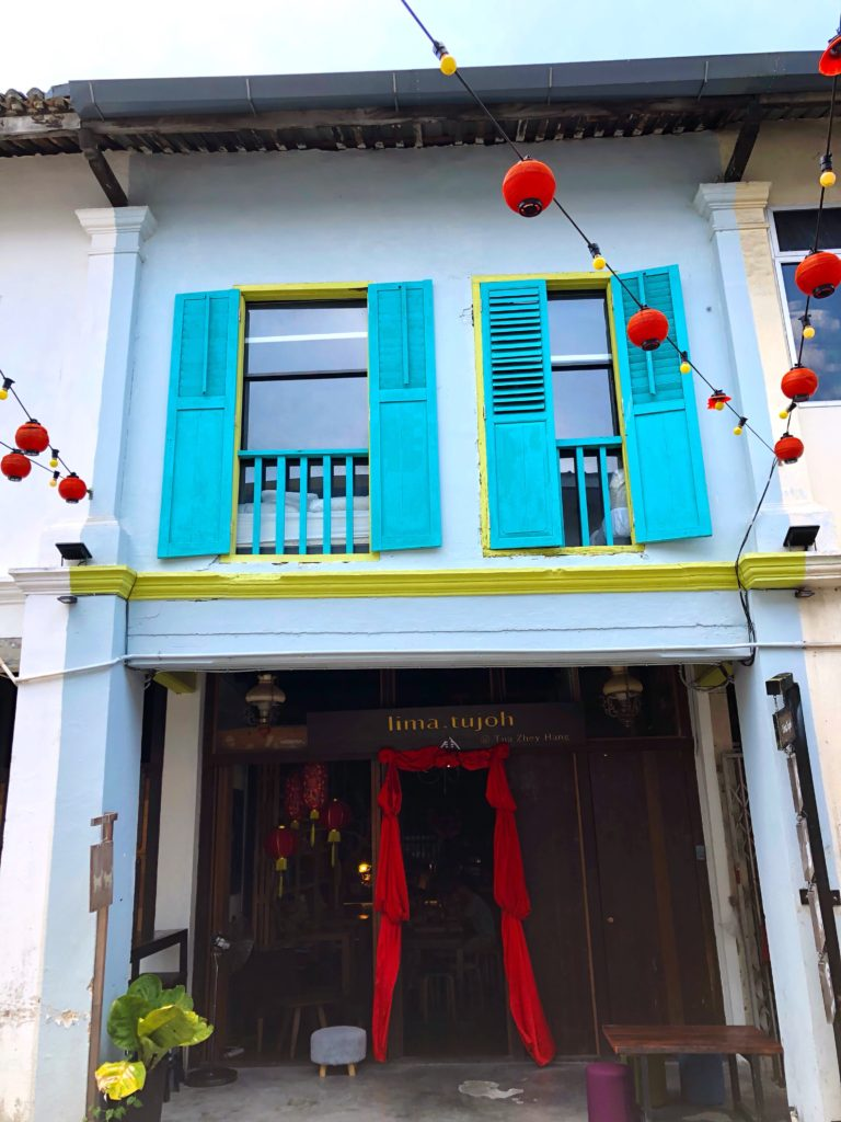 colourful building with shutters colourful kuching malaysia yellow feather blog