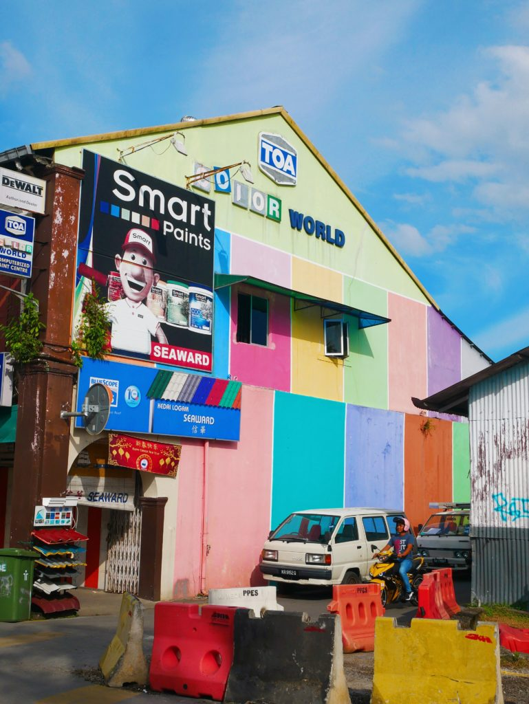 colourful painted building colourful kuching malaysia yellow feather blog