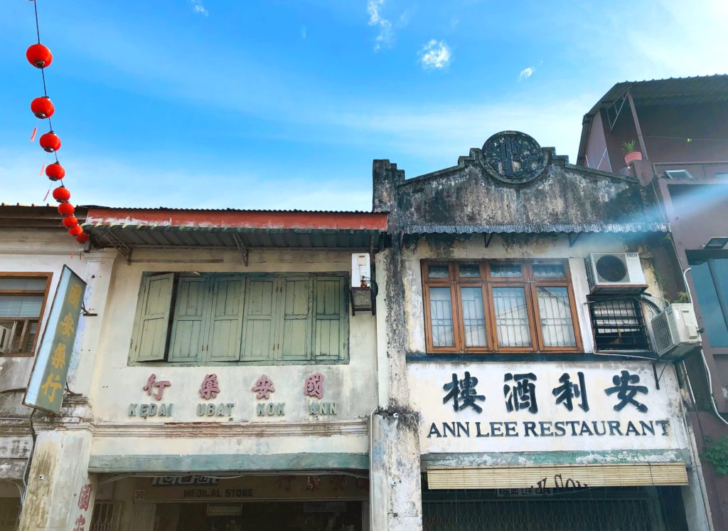historic colonial buildings chinatown colourful kuching malaysia yellow feather blog