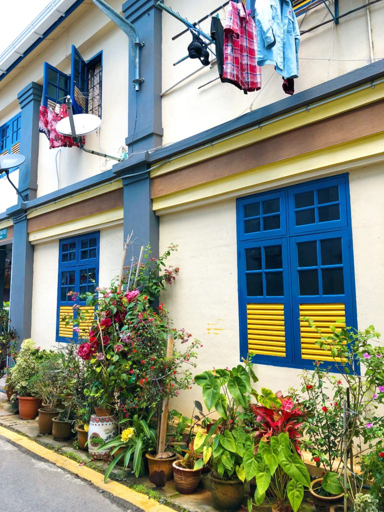 pastel colonial house painted shutters colourful kuching malaysia yellow feather blog