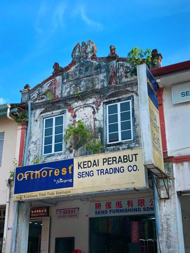 rustic colonial building colourful kuching malaysia yellow feather blog