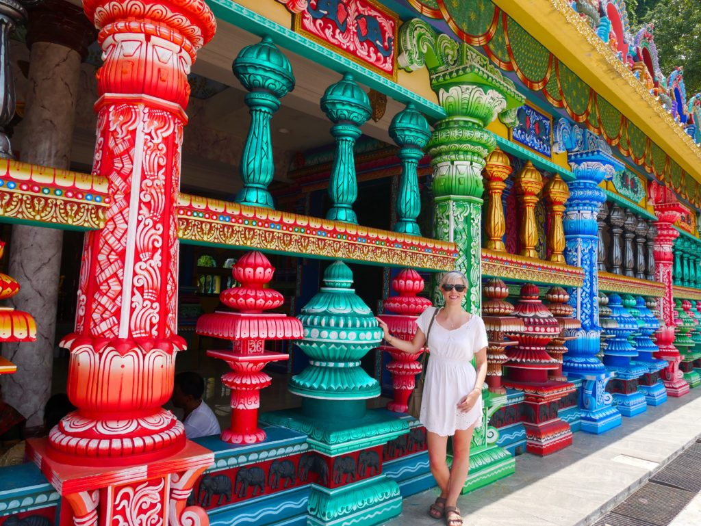 colourful pillars batu caves temple kl yellow feather blog
