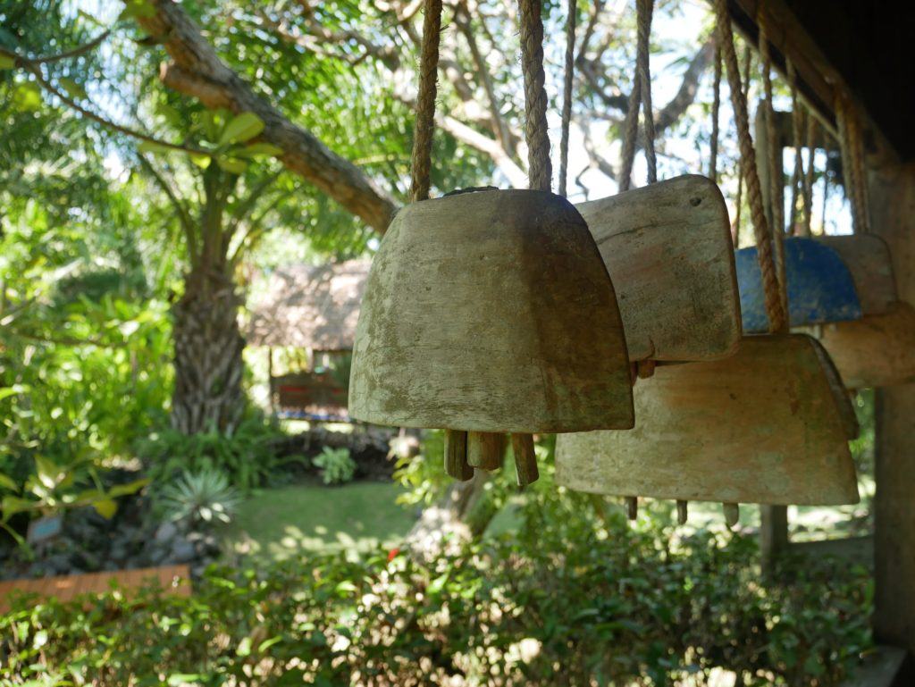 indonesian cowbells hung on terrace desa seni canguu bali 1