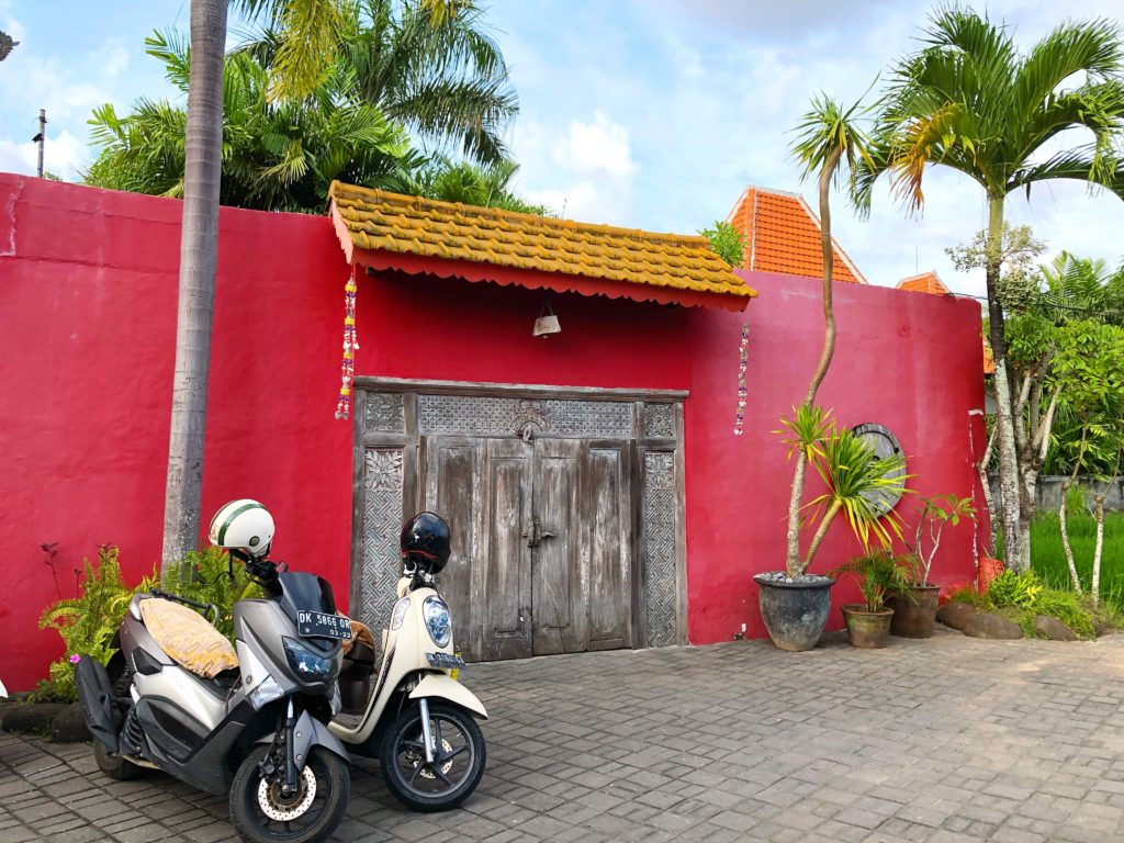 red walled building desa seni canguu bali yellow feather blog